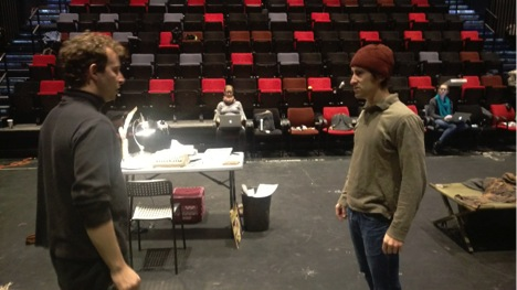 "Scott and Mateo rehearse, Anisa supervising, a moment in Holden.  Anne, our stage manager, is over on the right with the blue scarf.  Matteo's character (Zev), on the right, is teasing Scott's (Hinckley) about being a ""rhyming prosey man"".  They'll soon be on the floor wrestling."